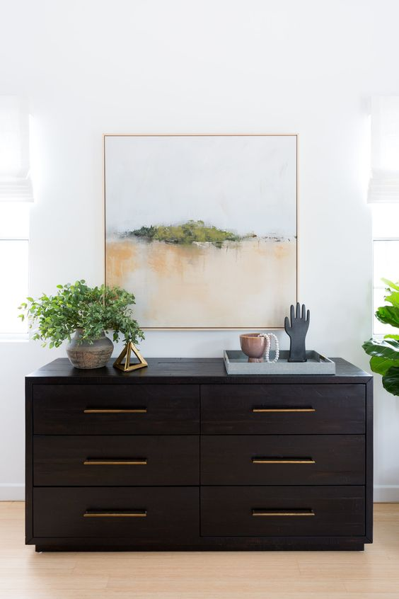a black accent dresser will make your neutral or colorful space more dramatic and will add a bold touch