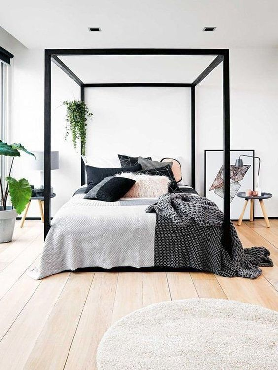 a black framed bed is a nice modern touch to your bedroom, and if you don't have it - just paint the existing one