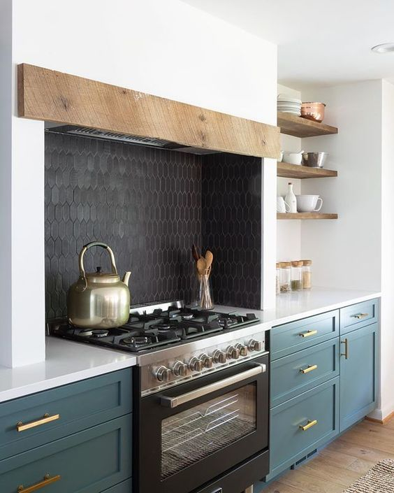 a black skinny tile backsplash and a black cooker add depth to the white and hunter green kitchen