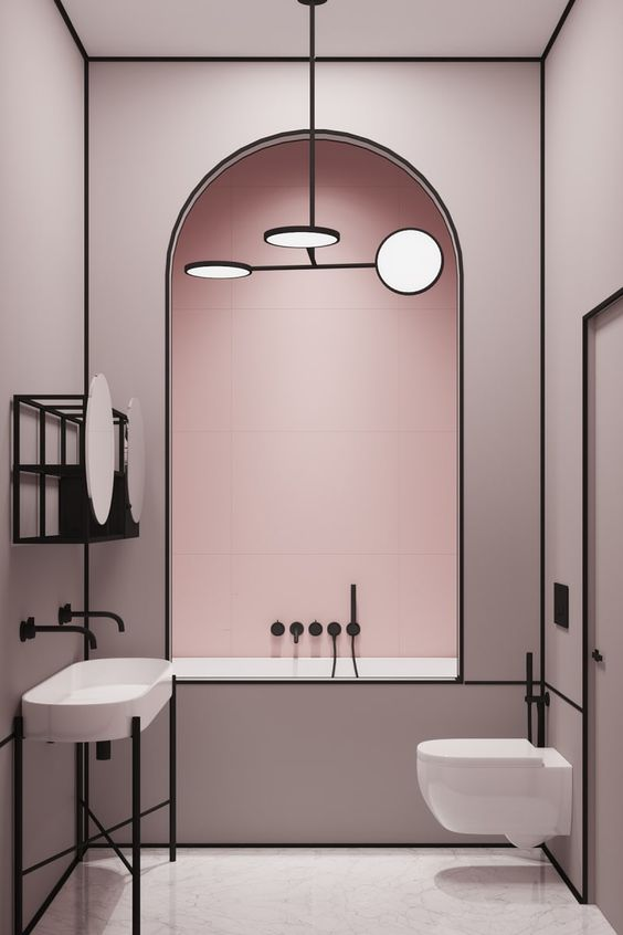 a chic modern light pink bathroom accented with matte black edges and lines looks very elegant and very bold