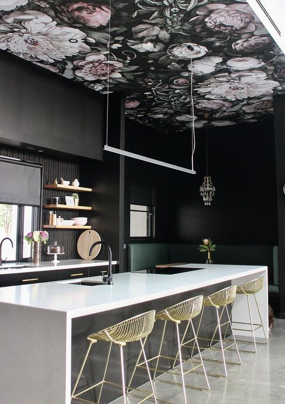 a dark dramatic kitchen with a moody floral wallpaper ceiling that adds charm and makes the space look softer