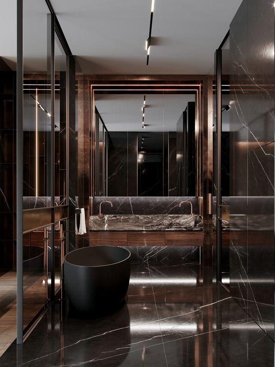 a jaw-dropping chocolate brown marble bathroom with a large mirror, a black soak tub and a shower space