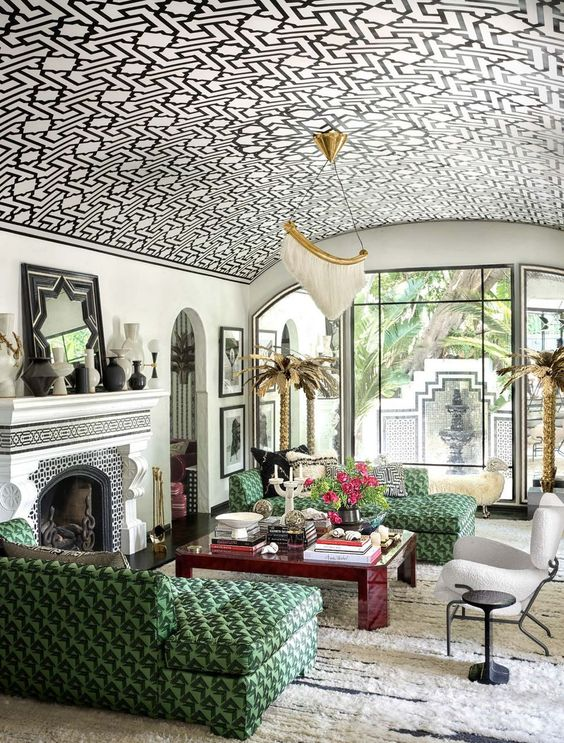 a jaw-dropping living room with a graphic wallpaper arched ceiling, the pattern of which echoes with the furniture below