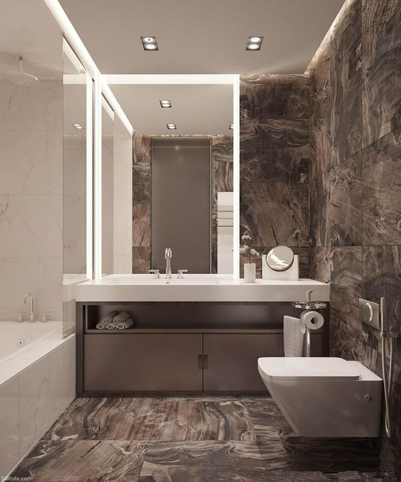 a minimalist bathroom with brown marble tiles, white appliances and stone surfaces is super chic