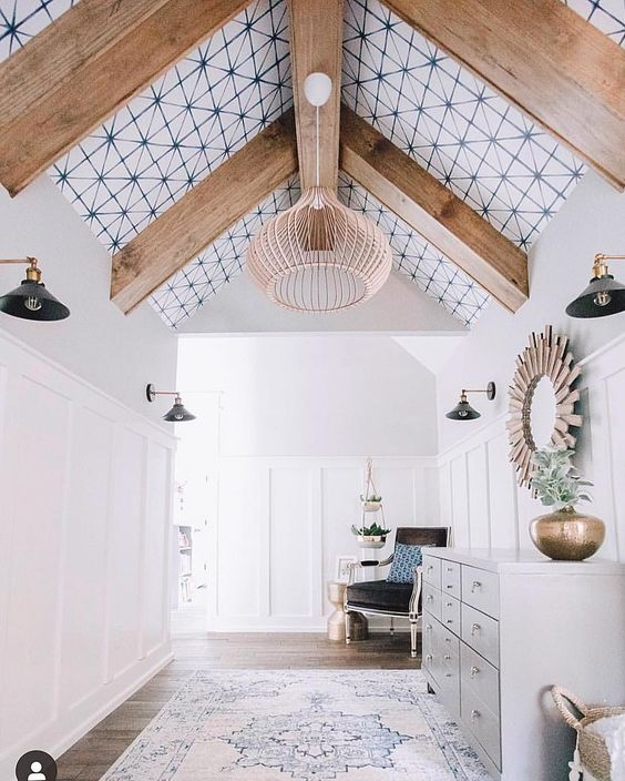 a stylish entryway with a printed wallpaper ceiling with wooden beams looks more unusual and more modern