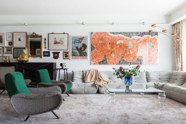 This bold and unique apartment created in eclectics features a backdrop for displaying art objects that belong to the owner