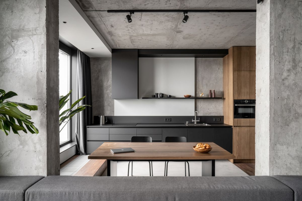 This modern apartment in a monochromatic color palette features a lot of concrete and looks absolutely timeless