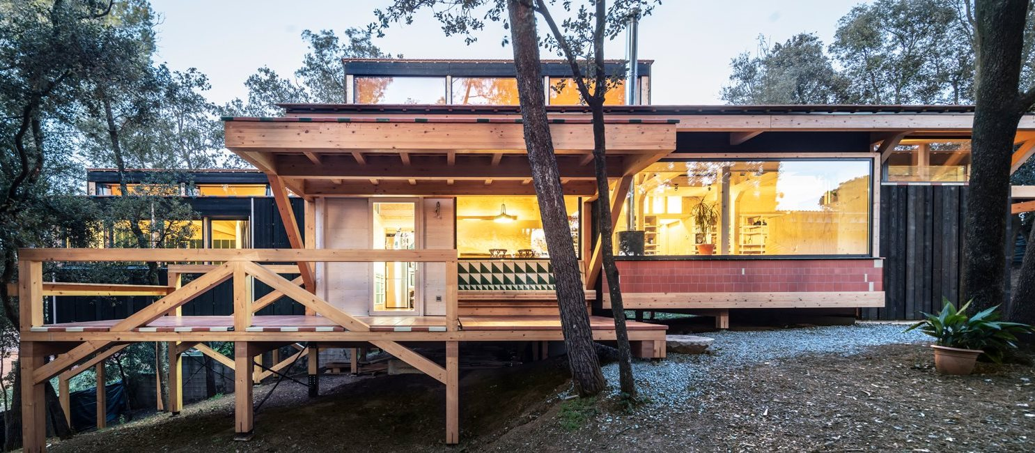 This stylish contemporary home in the woods near Barcelona is built to keep the existing topography and all the trees
