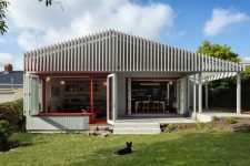 01 This ultra-modern home extension features mid-century modern interiors and lots of cedar in decor