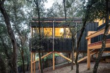 02 The house features much wood in design, both indoors and outdoors