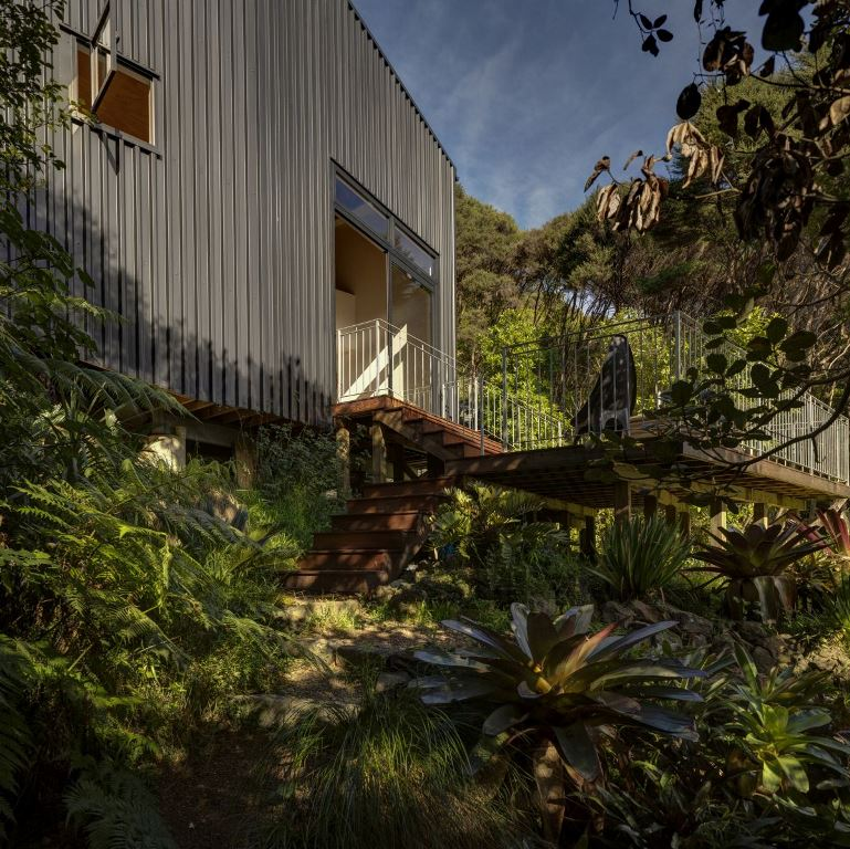 The house has two outdoor decks surrounded by dense vegetation and with access to the immediate surroundings