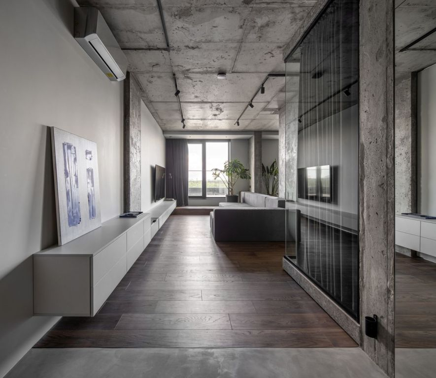 a cool industrial living space with lots of concrete