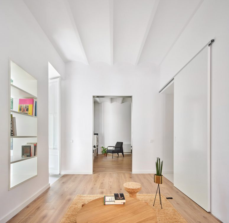 The apartment itself was refurbished but some features were kept, for example, this built-in shelving unit