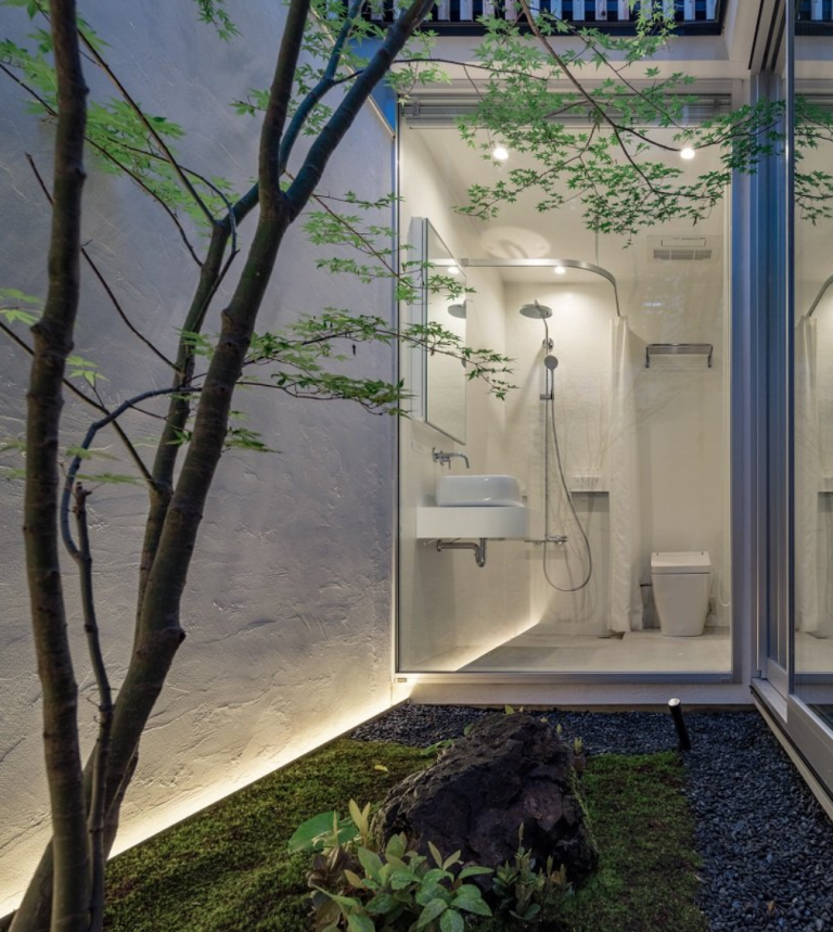 The bathroom itself is all-white and absolutely minimalist, with built-in lights