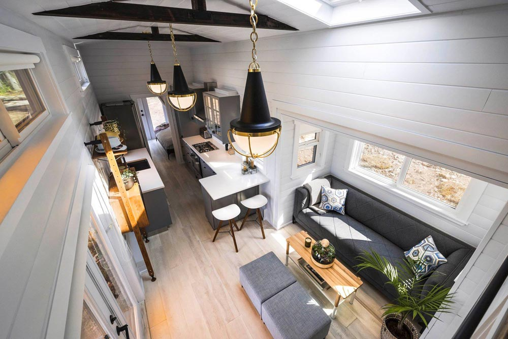 The interior is spacious, the layout is long and narrow, with a living room, kitchen, bedroom and a bathroom