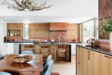 04 The kitchen and dining space are done in warm sandy shades and the design reminds of canyons