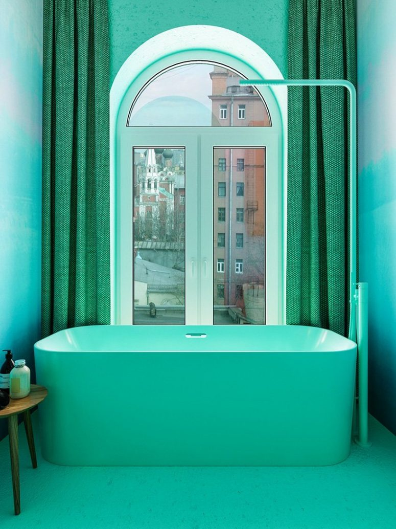 The master bathroom was done in green hues, with a window to enjoy the views of the city