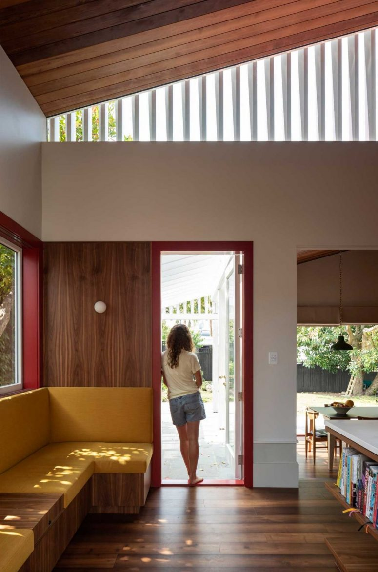The doors and windows show off red frames that burst the spaces with color and look extra bold