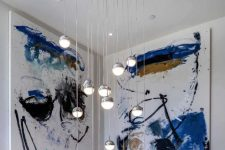 05 The staircase space is accented with bright artworks and pendant bubble lamps