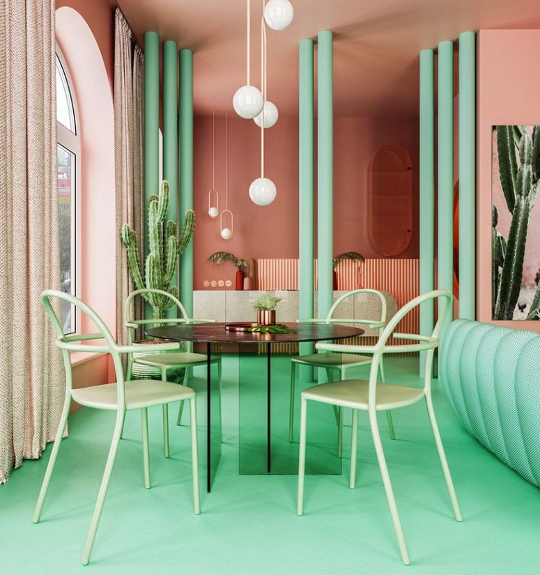 The dining space shows off a green glass table and green chairs plus pendant lamps