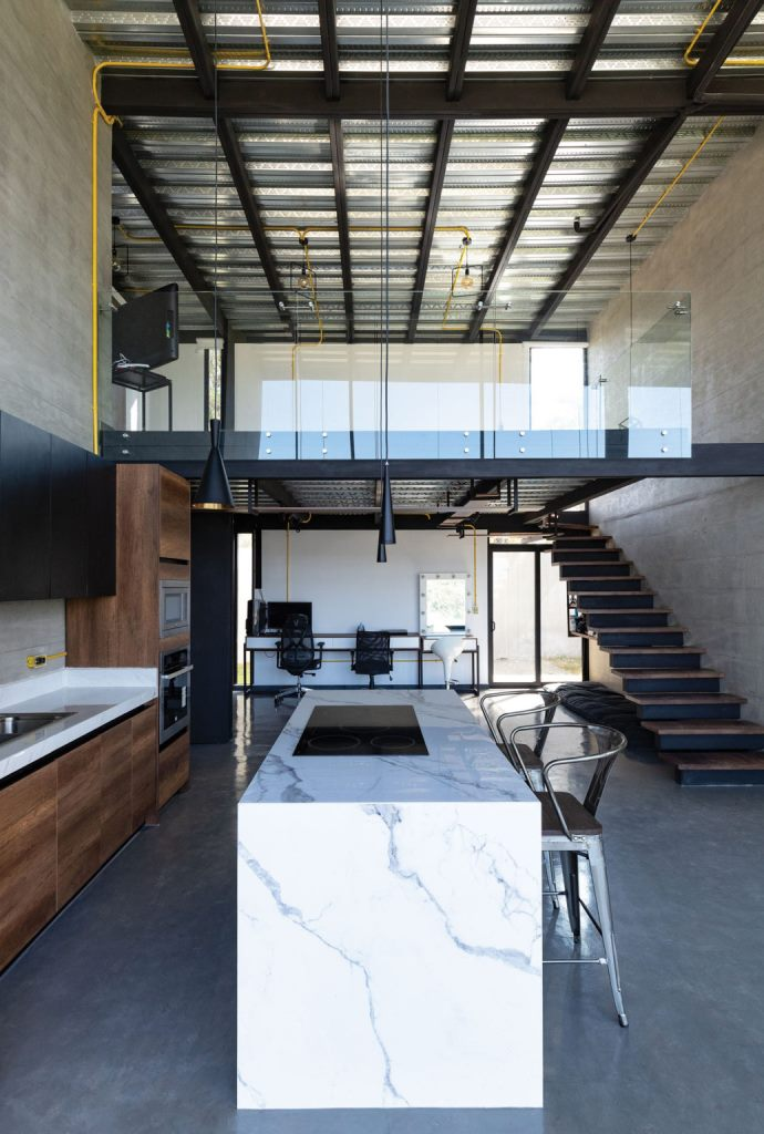 The kitchen island is also used for eating here, and there's a double work space at the end of this room