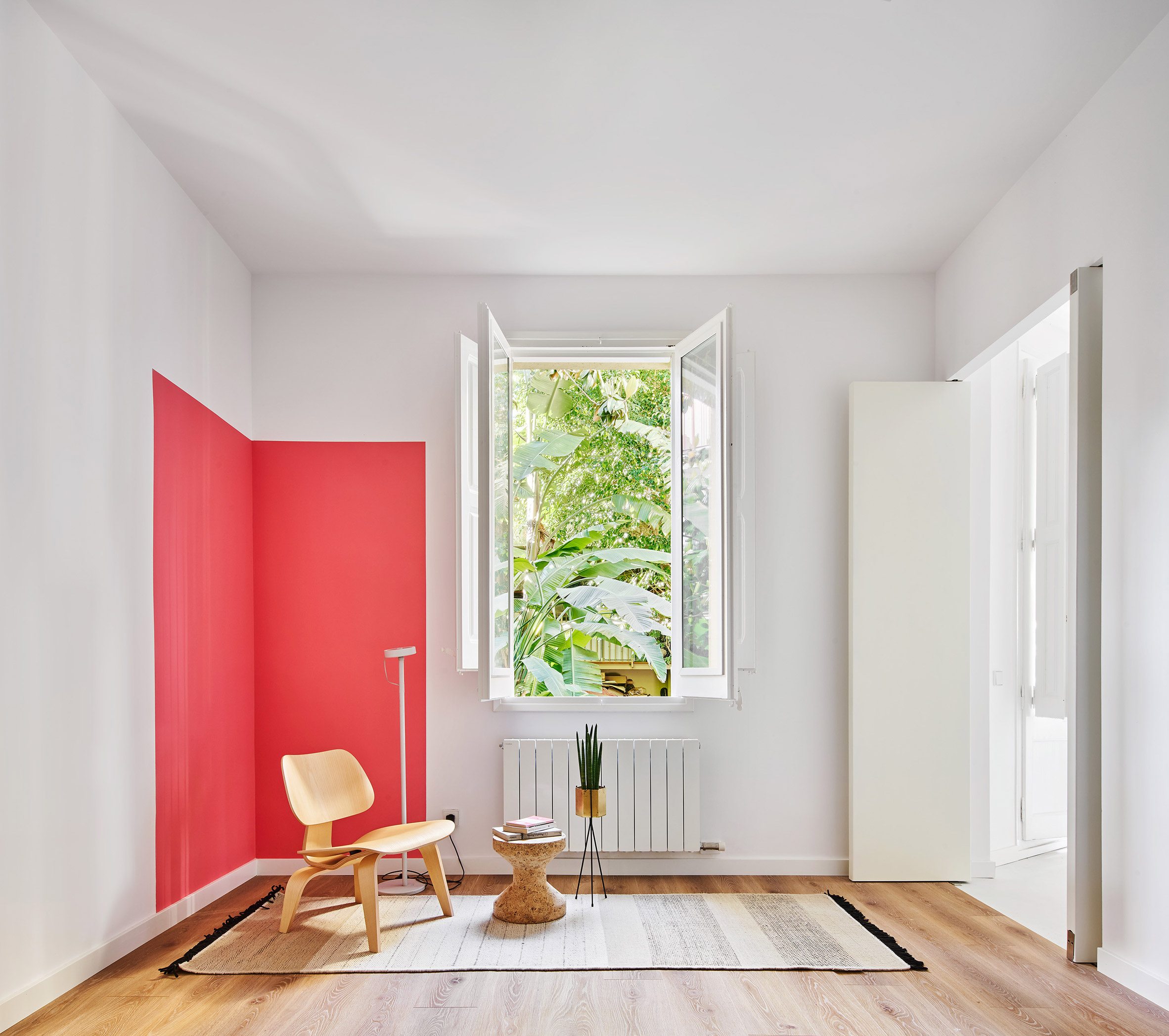 This space is accented with a bright red square that adds interest to the space easily