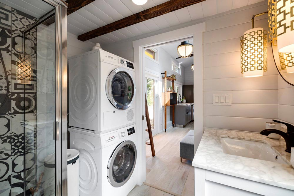 a small bathroom with smartly organized laundery space