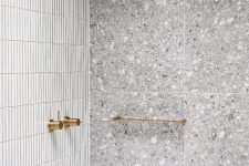 bathroom with stone and skinny tiles mixed together