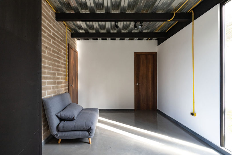 Bright yellow cords and tubes are a cool bold touch to the space