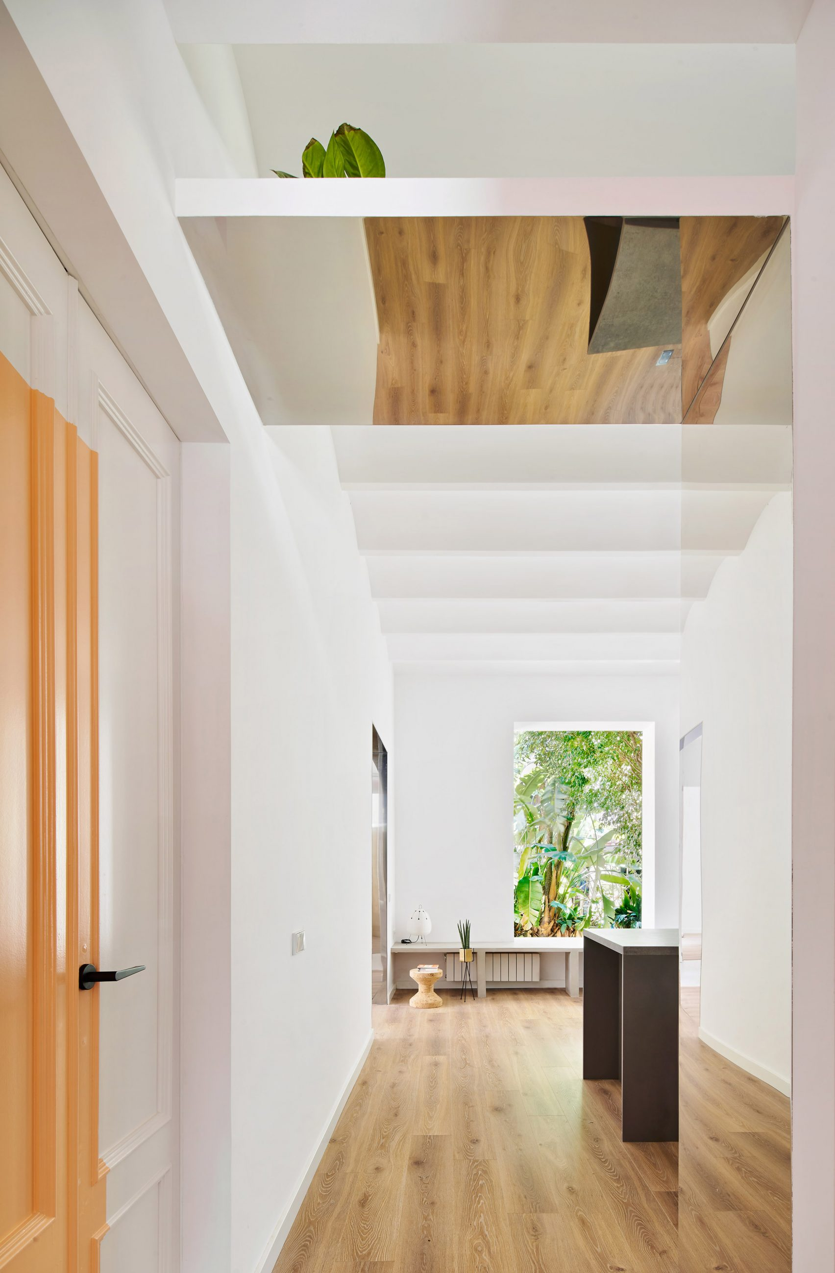 The apartment feels spacious, airy and bright thanks to large windows in each room