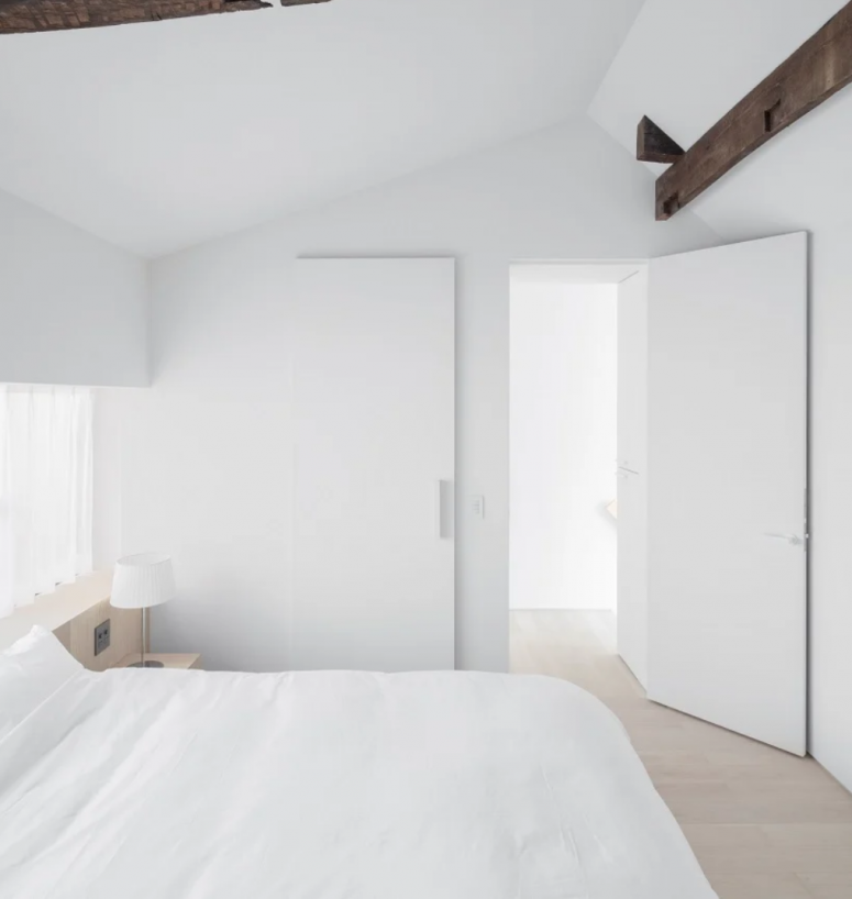 The bedroom is all-white, sleek and plain and looks aboslutely peaceful and welcoming