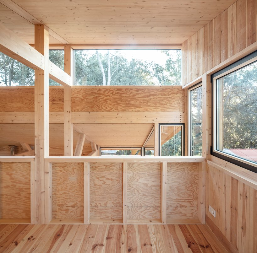 Lots of windows and skylights fill the interiors with natural light