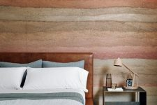 09 The canyon-inspired accent wall is continued in this bedroom, too
