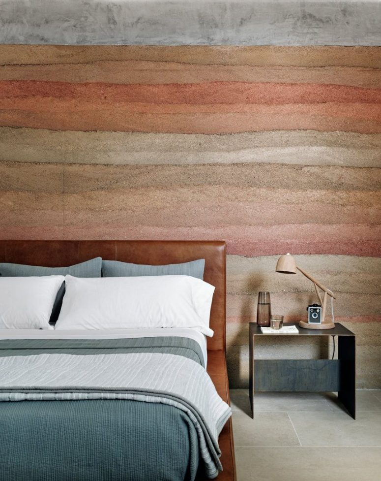 The canyon-inspired accent wall is continued in this bedroom, too
