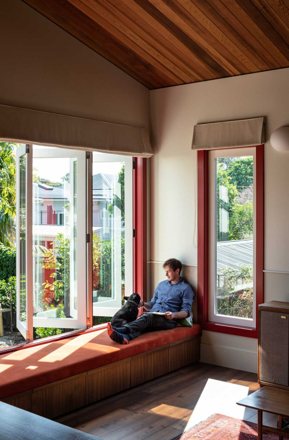 The window is done so that the owners can completely open this space to outdoors