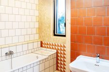 10 The bathroom is done with white and terracotta tiles and some timber again