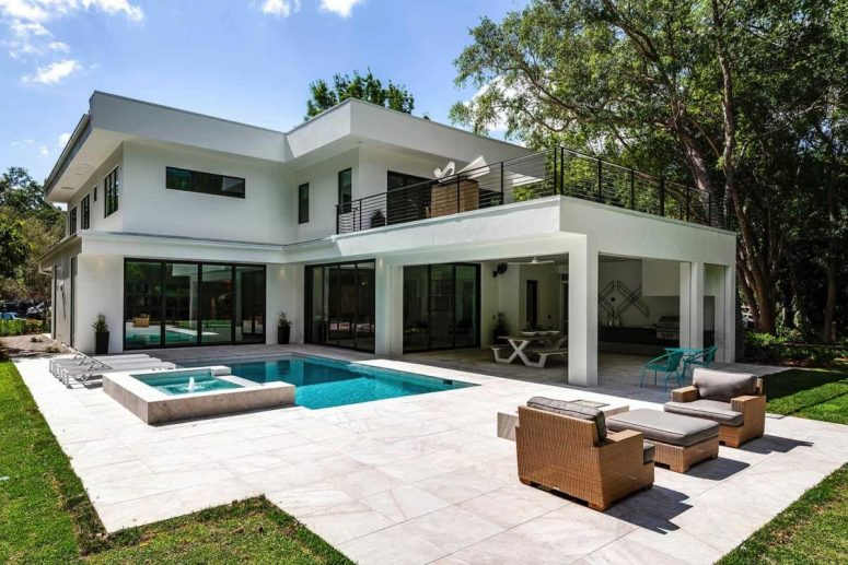The outdoor space features a pool, a hot tub and a lounge space, too