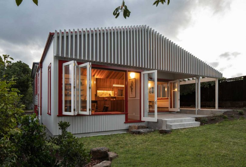 What makes this extension exterior special is a cool wooden screen that covers it all