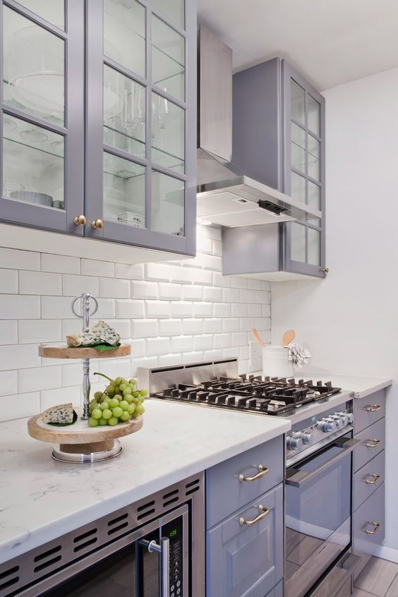 a chic lilac kitchen with a white subway tile backsplash and white stone countertops looks very romantic