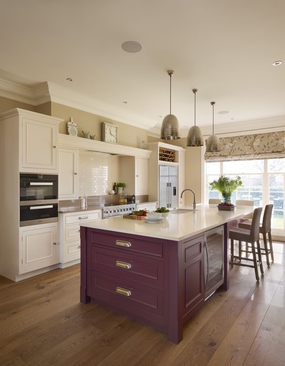 a neutral kitchen with a purple kitchen island and metallic pendant lamps is a stylish and cool idea to rock