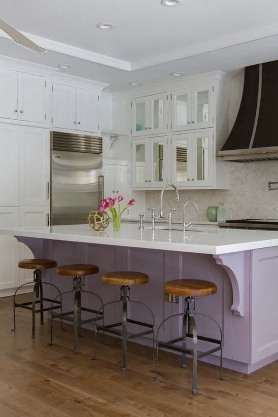 a neutral vintage kitchen with a lilac kitchen island, white countertops, a whte tile backsplash and wooden stools