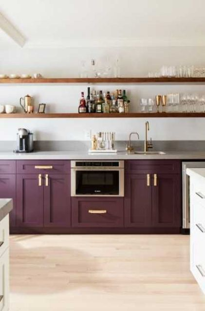 a purple kitchen with only lower cabinets and open shelving instead of uppers is an elegant and chic space