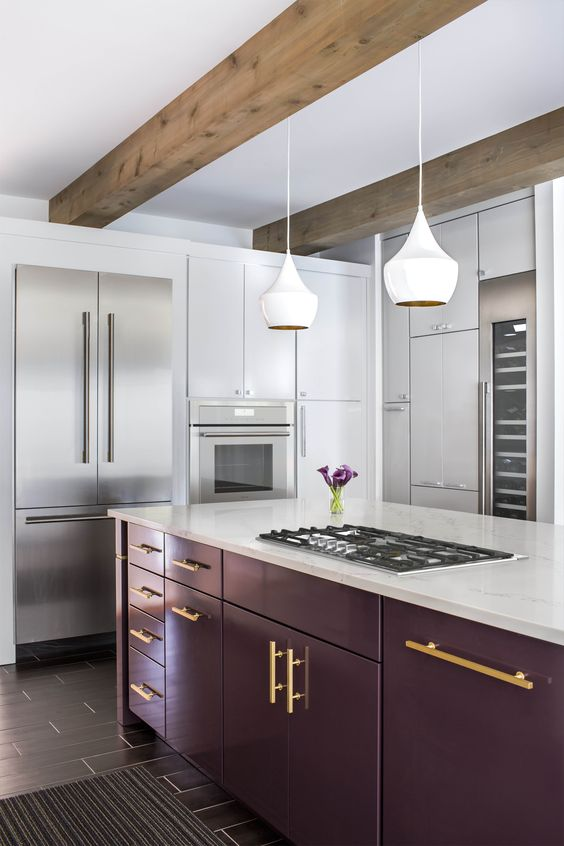 a stylish contemporary kitchen in white accented with a bold purple kitchen island and touches of gold is wow