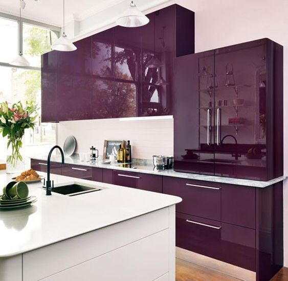 a super bright and juicy purple kitchen with a white backsplash and a white kitchen island is minimal and chic