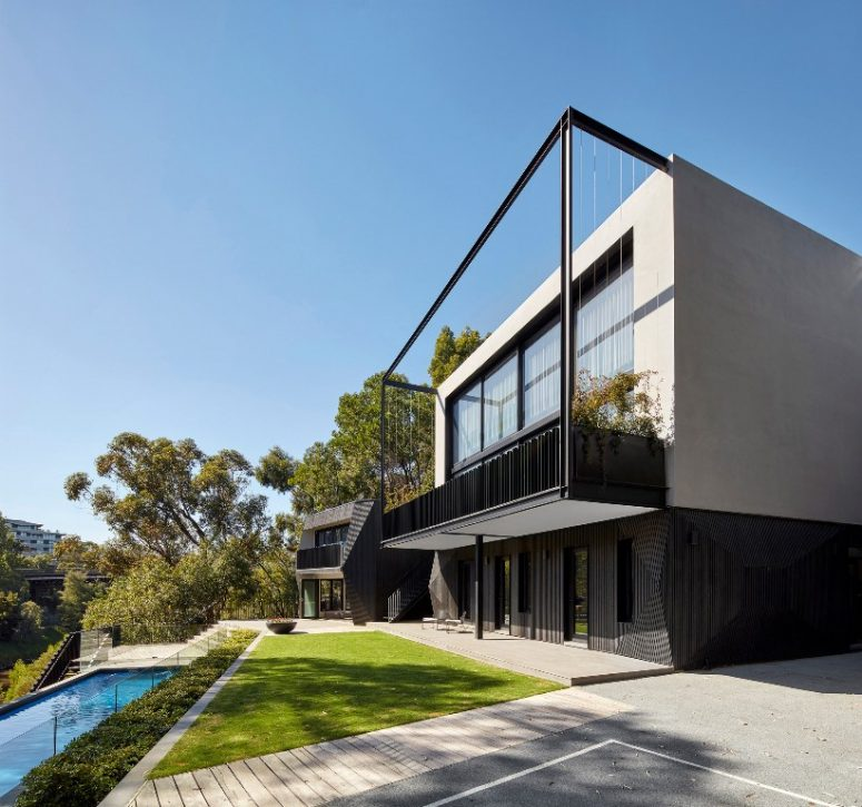 This contemporary house with an extension and a pool was built by an architect and a designer for themselves and their kids