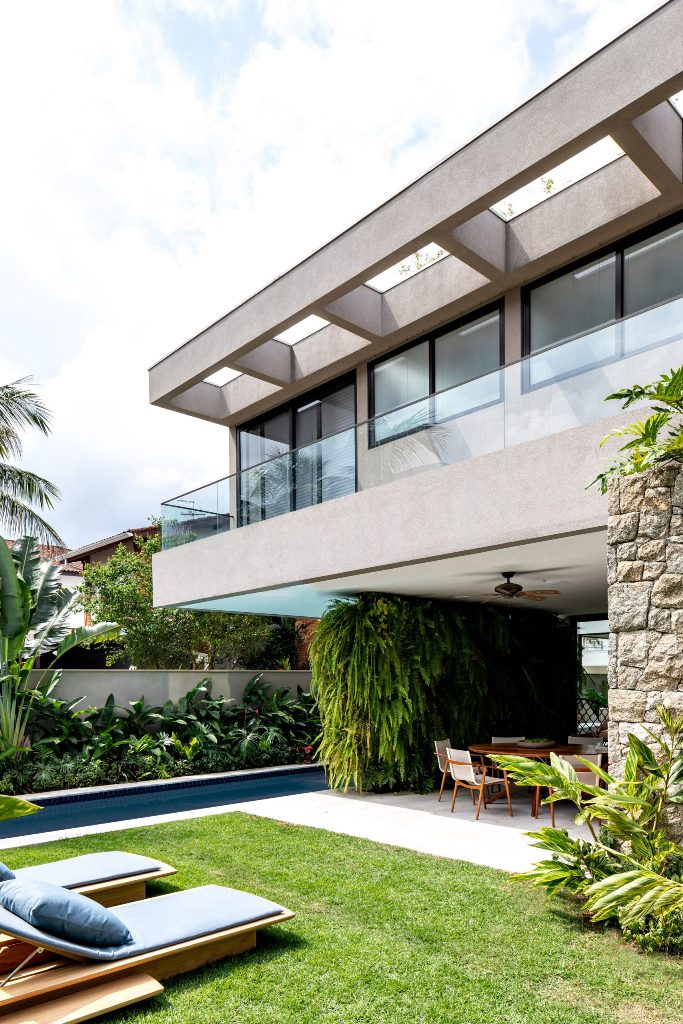 This gorgeous contemporary house is located in Brazil and features outdoor indoor living at its best