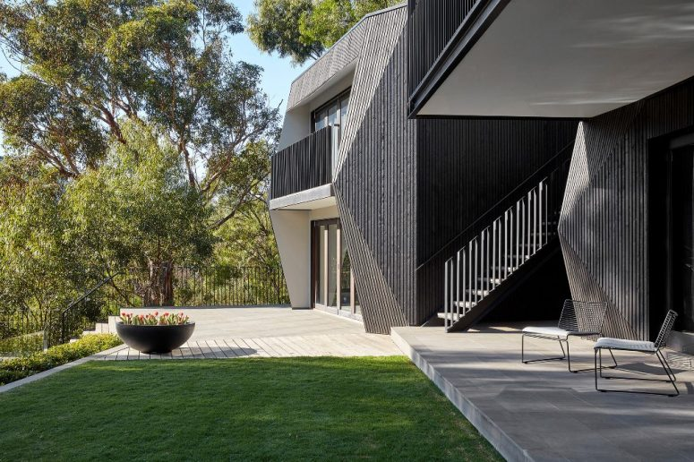 The house is clad with black cypress, concrete and blackened steel to give it an ultimate look