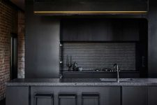 03 Black fixtures and a penny tile backsplash continue the moody color scheme