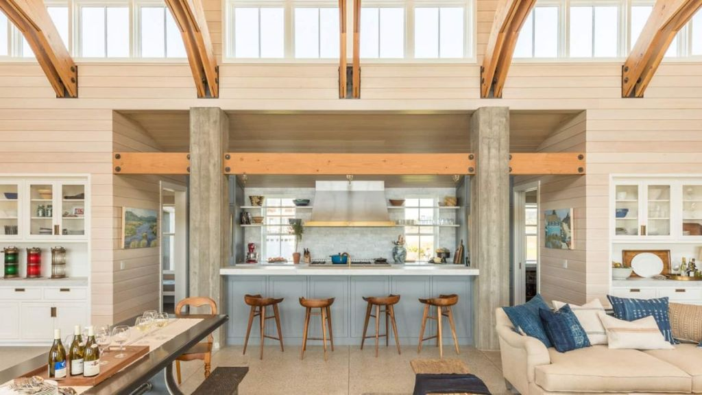 The kitchen is sunken between living and dining rooms, there's an additional meal space at the kitchen island