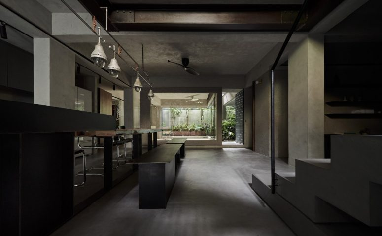 The spaces are vast, the materials and furniture create a cohesive look and the views are focused on the inner courtyard